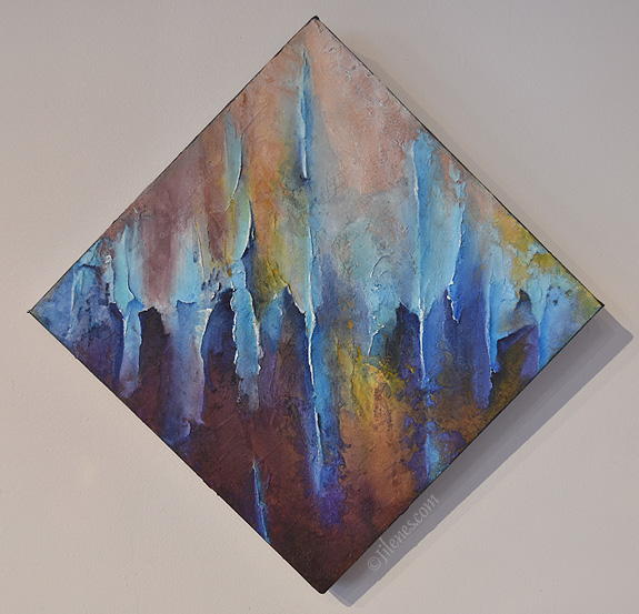 diamond shaped multicolored, sculpted abstract painting, featuring vertical lines, peaks and valleys