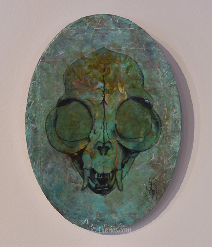 oval canvas mixed media painting of a Persian cat skull