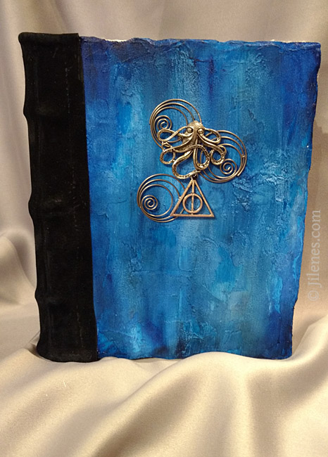 Blue Hard cover hand bound journal with octopus and geometric designs in metal