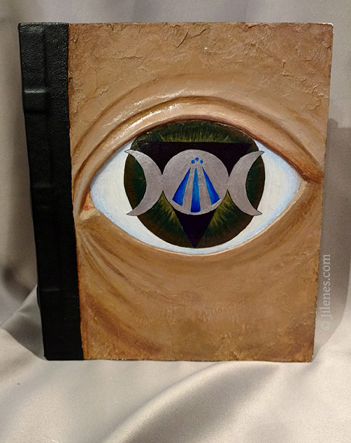 hand bound, hard cover journal with sculpted eye design and symbolism