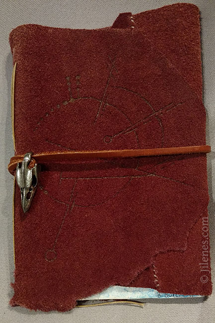 soft cover hand bound maroon leather journal with geometry and bird skull