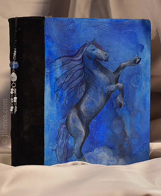 Hard cover hand bound journal with bucking Fresian horse